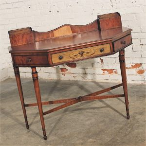Beautiful and wonderful antique French unusually shaped desk. Absolutely gorgeous hand-painted design and warm wood finish in excellent vintage condition except for missing veneer on upper back.  | www.warehouse414.com