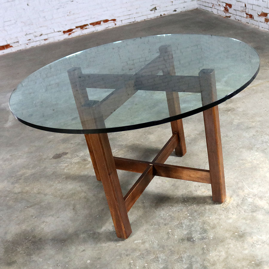Modernist x base dining room table with round glass top for Round glass dining table