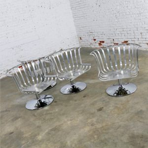 Polished Aluminum Tulip Shaped Swivel Lounge Chairs by Russell Woodard Set of Four